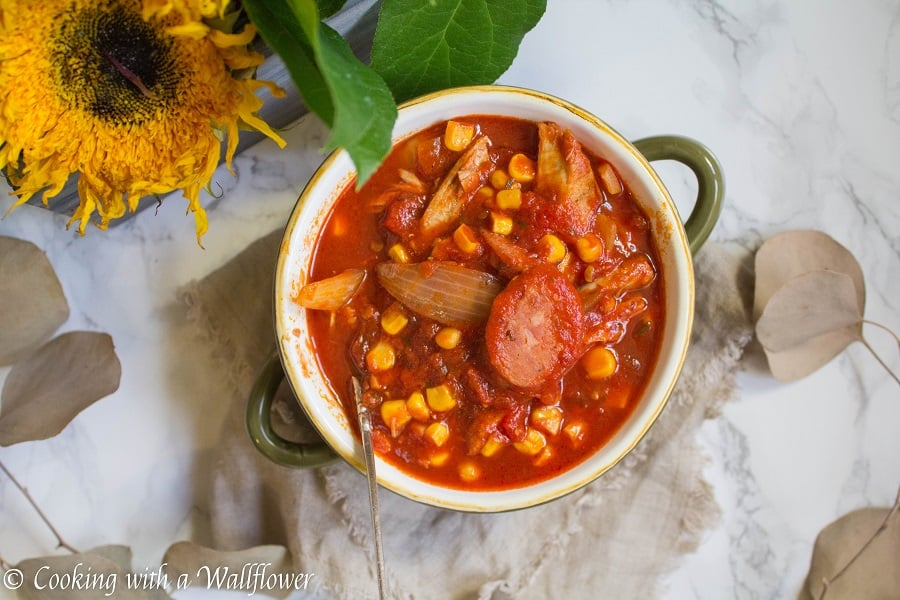 Warm, comforting chili filled with chicken, sausage, and veggies. This smoky chicken and sausage chili is delicious, healthy and perfect for the winter. | Cooking with a Wallflower