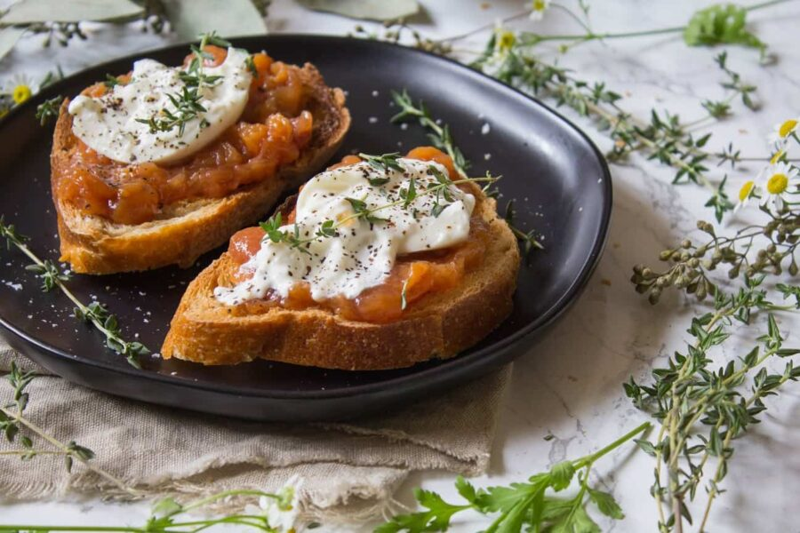 Toast topped with sweet peach jam, creamy burrata, thyme, salt and pepper. This Peach Jam Burrata Toast is delicious and perfect for breakfast or a late summer snack. | Ask Anna