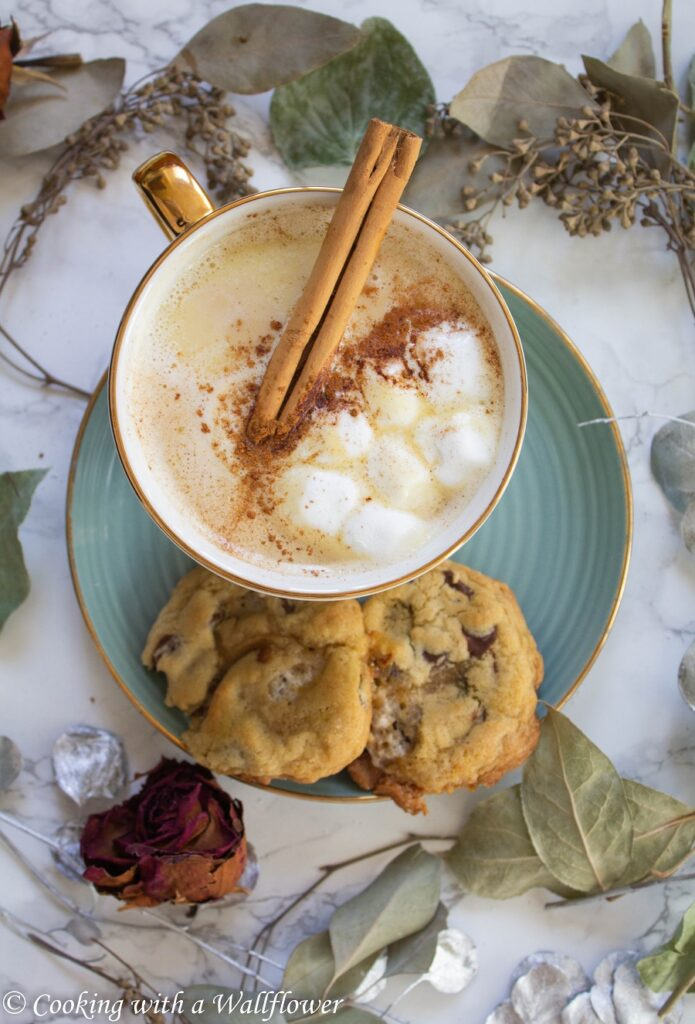 White hot chocolate brewed with chai tea, topped with mini marshmallows and a sprinkle of cinnamon. This chai white hot chocolate is easy to make and perfect for cold winter days. | Cooking With a Wallflower