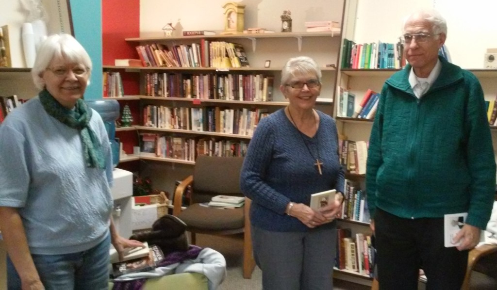 Sue (center) & Tom and Mary Ellen caught conspiring in the Book Room.  Tom and Mary Ellen worked tirelessly in this little room for 3 months to prepare it for Sue to take over (see entire story on our Blog, February 3, 2017).  Sue continues to come in several times during the week to keep the books organized and also update the displays for the upcoming holidays.  She also helps with customers and blesses all who have the privilege of meeting her.  Often, people will sit in the Book Room and visit with her, sharing their faith and prayer requests.  These are precious people!!!