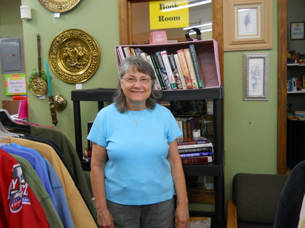 """Kathy has been volunteering at the Community Center since it opened in 2013.  She continues to come in every week to lovingly put our linens together, decorate our store with her creative touch, and help customers at the register.  She always seems to have something homemade or from her garden to bring us when she comes in.  She is such a light and blessing to this ministry!"""""""