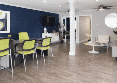 summercrest apartment homes leasing office with green chairs and decor