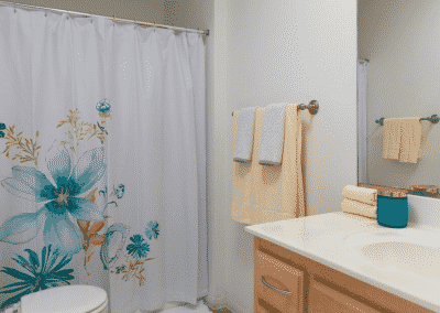 bathroom with floral shower curtain