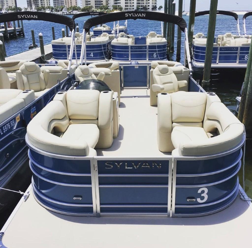 Pontoon boat docked at the marina in Destin, Florida