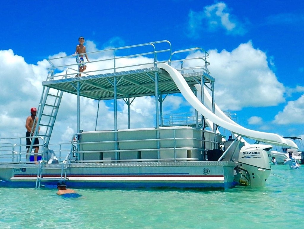 Pontoon boat in the middle of the waters of Crab Island, Destin, Florida.