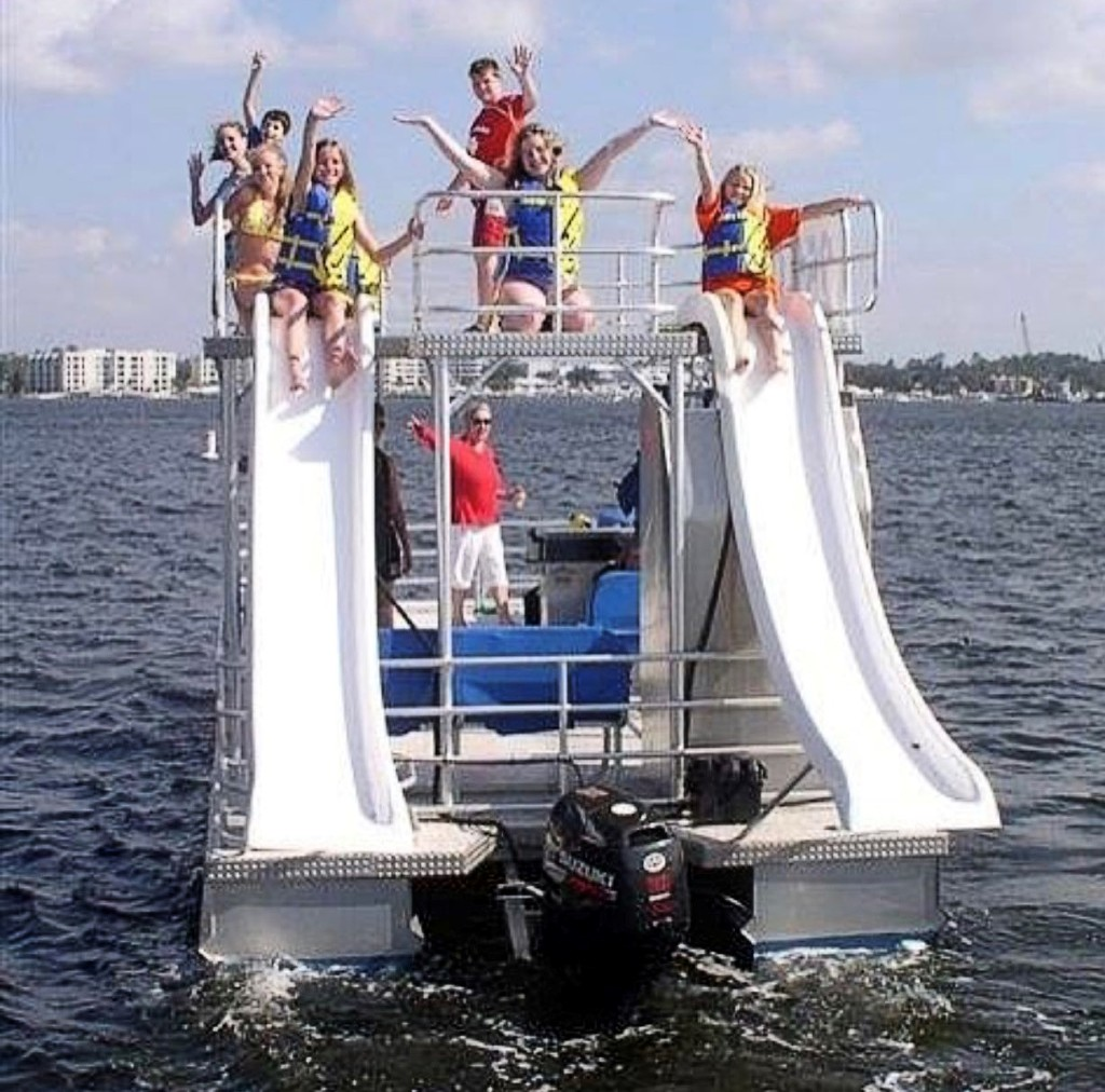 Family on a pontoon boat in the middle of the waters of Crab Island, Destin, Florida.