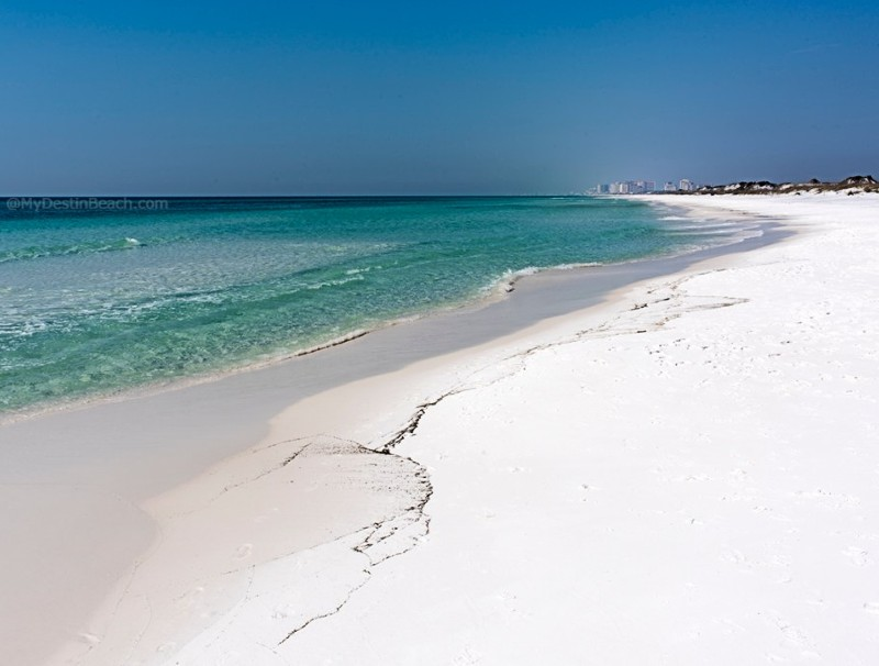 White sand beach at topsail hill state park in florida with camping