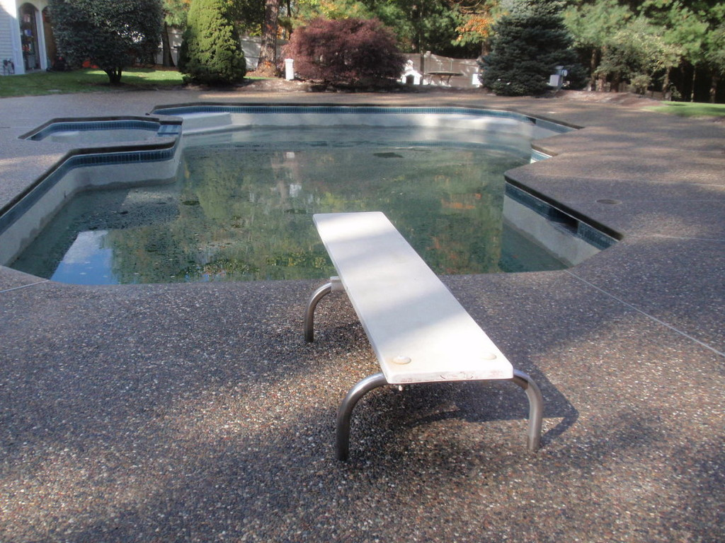 Photo of exposed aggregate concrete pool deck sealing - medway - ma