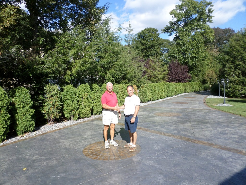 see a stamped concrete patio and driveway completed