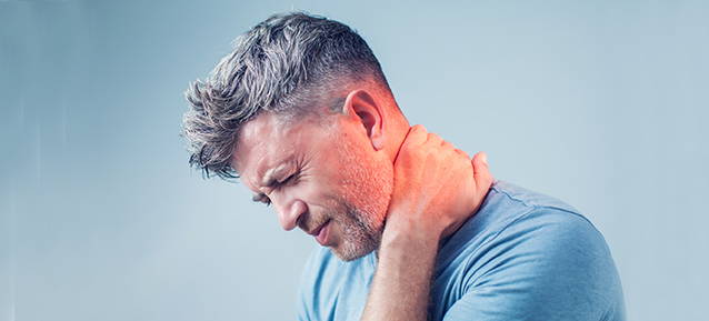 man suffering from neck pain before minimally invasive spine surgery with dr. nasser ani