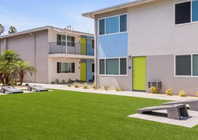 Grassy courtyard with view of apartment units