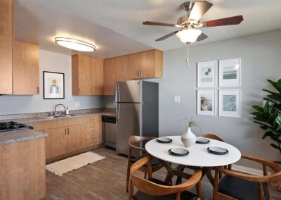 The Circle Apartments facing the kitchen area with wooden cabinets and dining area