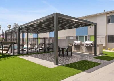 Outdoor Gazebo and Barbeque Grills with grass and covering