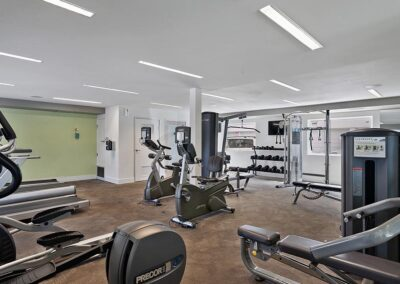 Fitness center with equipment and windows