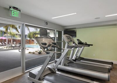 Fitness Center with treadmills and green wall