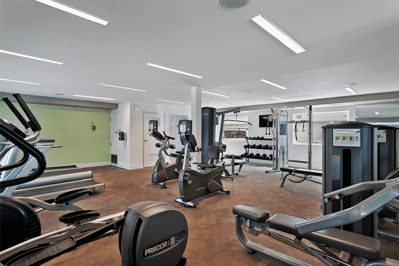 Fitness Center with equipment and mirrors