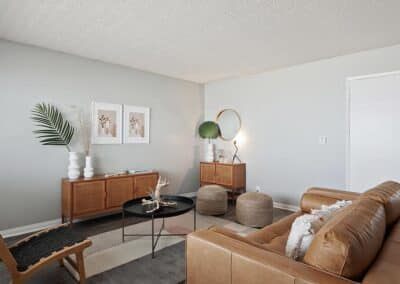 The Circle Apartments Carpeted floor living room with brown sofa and cabinets