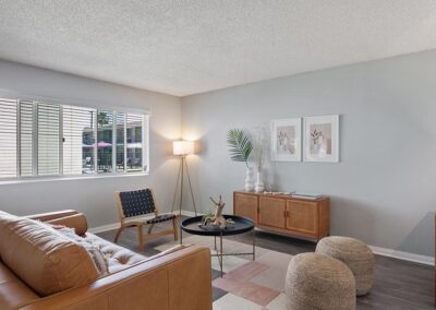 Living room with sofa, cabinets, and decor