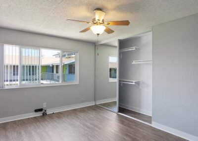 The Circle Apartments Empty Bedroom with Large Closet and ceiling fan