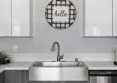 Kitchen sink with hello sign hung above it