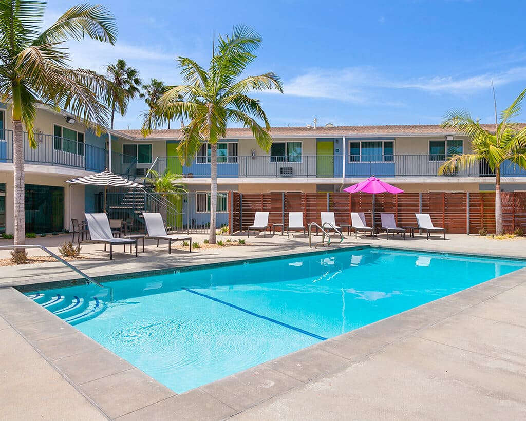 Swimming Pool with Palm Trees and lounge chairs