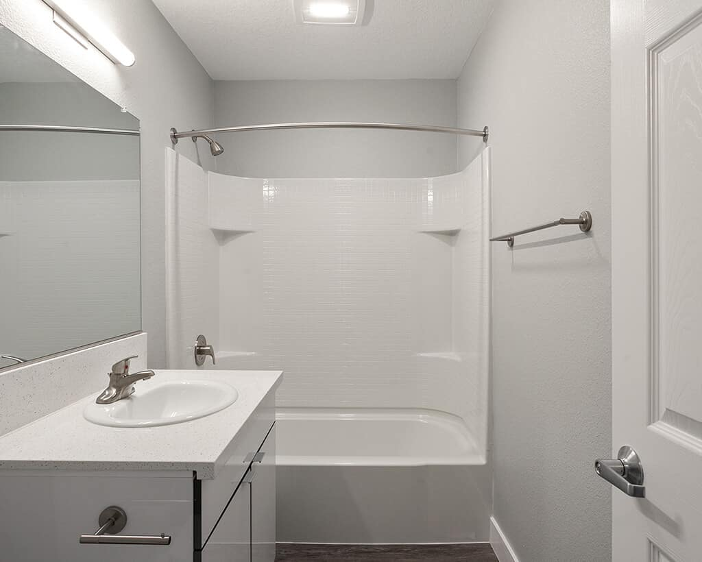The Circle Apartments Bathroom with white sink and bathtub