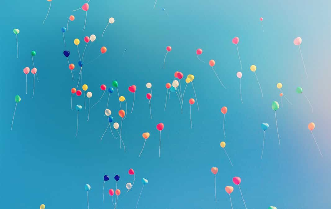 balloons floating in sky