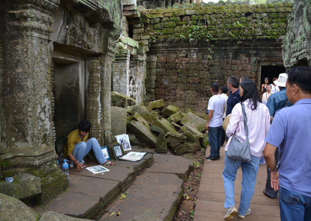 An older ODA boy paints at one of Siem Reap's ancient temples, earning money for his college education.
