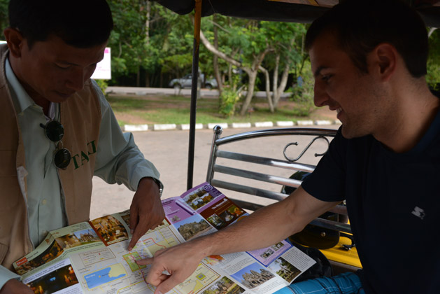 My brother Andy discussing the temples we would like to visit with our tuk tuk driver.
