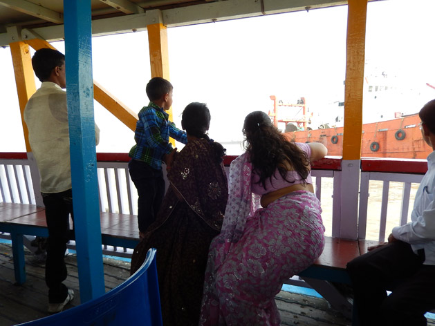 Indian family enjoying seeing all the large ships up close.