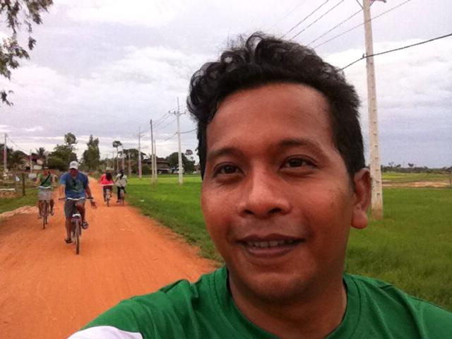 Yan selfie with us on the bike tour in the background