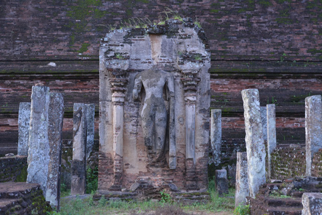 An old statue, missing its head.