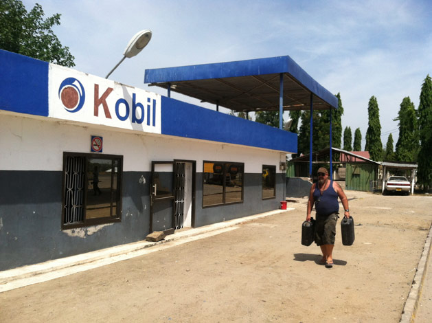 Mick fills up water jugs at a fake African Mobil station named Kobil.