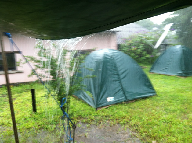 Rain pouring off of our cooking canopy at breakfast.