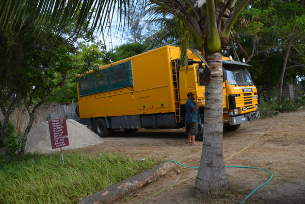 Our driver Mick locks the truck up for the day on our beach campsite.