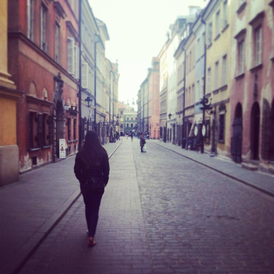 Alissa walking through Warsaw's Old Town.