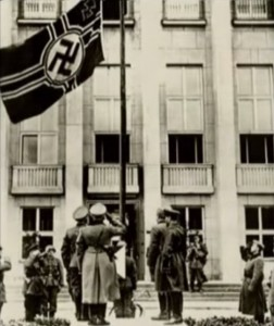 Soviet troops saluting the Nazi flag during the beginning of WWII.