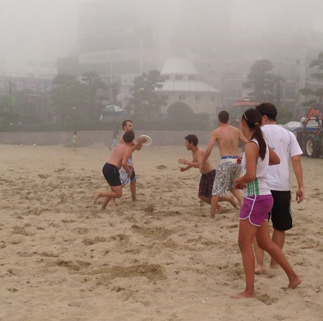 Playing beach ultimate frisbee in Busan, South Korea