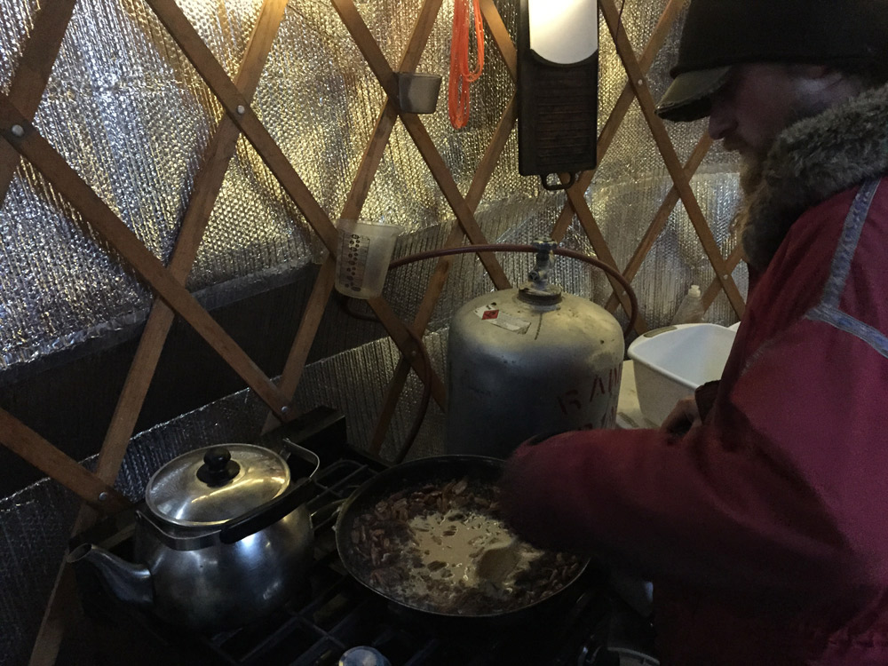 Paige making wild rice porridge for breakfast.