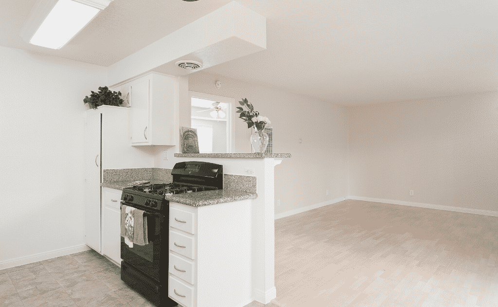 Empty kitchen with view into living room