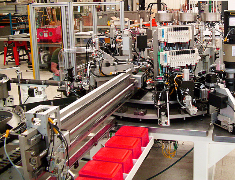 An assembly machine with individual reject bins for different failure modes.