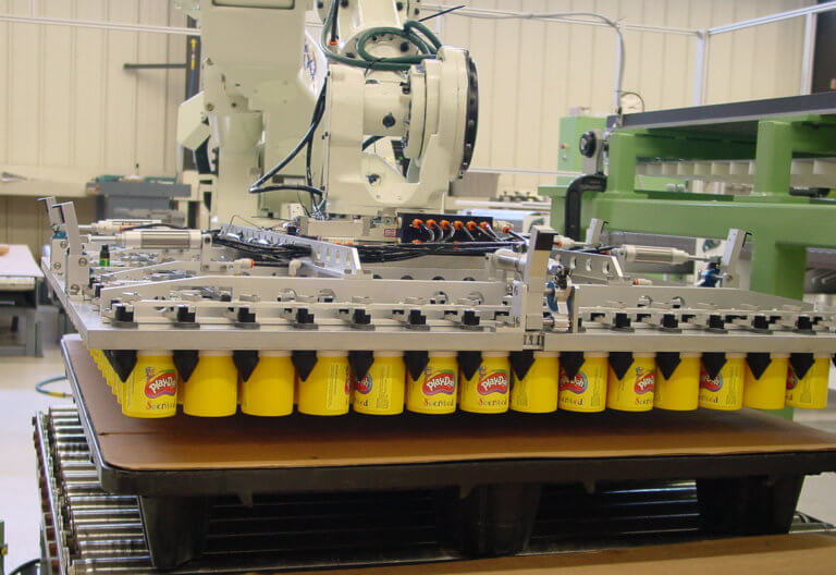 The robot's special end-of-arm-tool securely holds an entire layer of product.