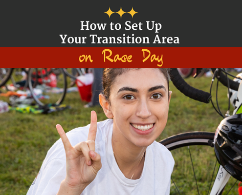 Triathlete makes the longhorn symbol with her right hand while setting up in transition race morning. Text on design reads How to Set Up Your Transition Area on Race Day. Read more at https://captextri.com/set-up-your-transition-area/