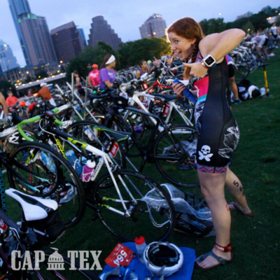 Female triathlete gives a thumbs up after setting up her triathlon area at the 2018 CapTex Triathlon.