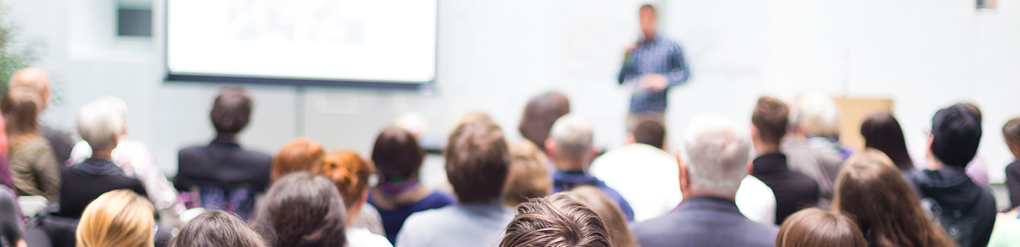 Events Banner Picture - Speaker Giving a Talk at Business Meeting. Audience in the conference hall.