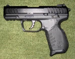A semi-auto pistol, the Ruger SR-22 (.22LR caliber)