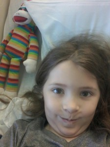 This is classic Lia, making a goofy face. She texted this photo to me today (Day 9 at the hospital), while I was at the office. She claimed that the sock monkey photobombed her.