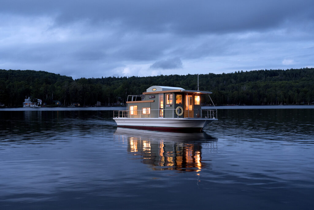 Floating Camp Nomad on Rangeley Lake at dusk