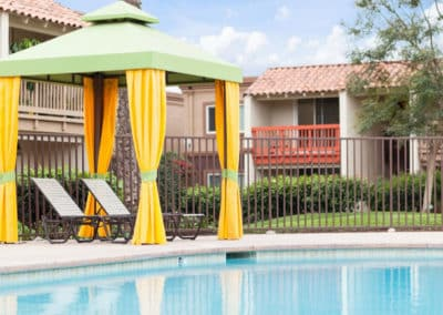 Paved pool with shaded outdoor seating