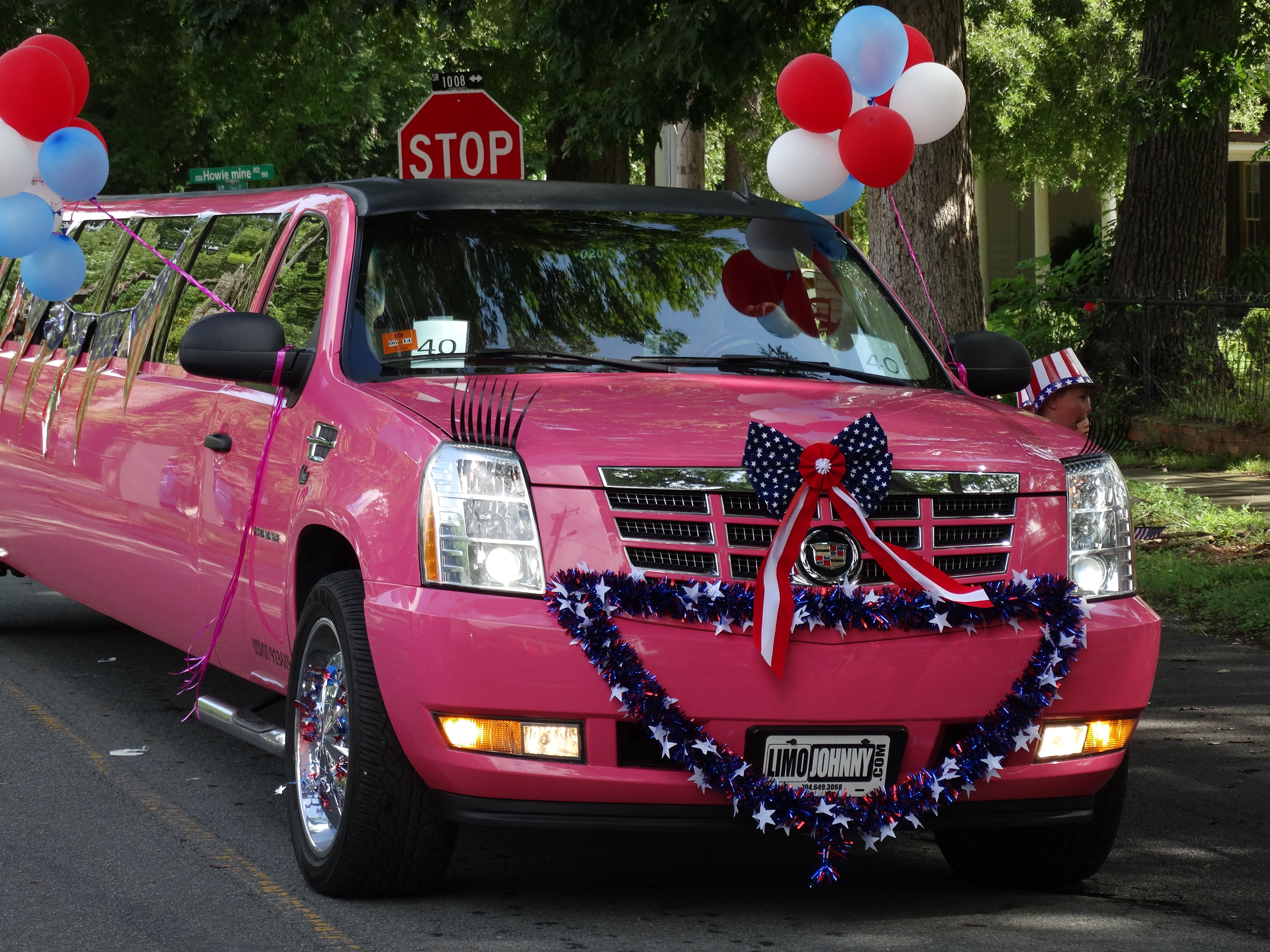 Carolina Luxury Transportation Group pink limousine in the Waxhaw Parade for fourth of July
